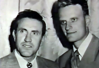 Louie with Billy Graham