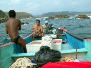 Pastor Damian (facing camera) lobster fishing