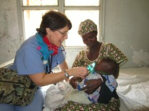 Laura Delany ministers to child in Mali village