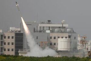 Missile from Iron Dome defense system launches to intercept missile fired from Gaza