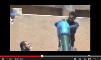 Rebels allegedly load chemical weapons on launcher