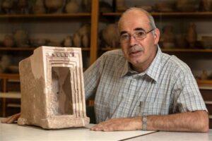 Yosef Garfinkel, an archaeologist at the Hebrew University of Jerusalem, shows off a stone shrine model that was found during excavations at Khirbet Qeiyafa (photo courtesy Hebrew University of Jerusalem)