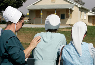 Amish women mourn at site of school shooting