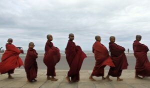A group of Sri Lankan young Buddhist monks parade, seeking alms in Colombo, Sri Lanka.