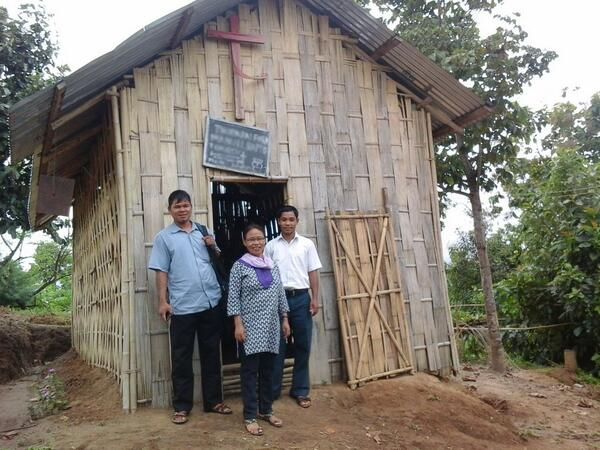 Former Buddhist monk and his wife with church member