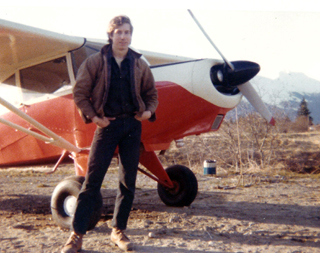 Mark standing next to his plane