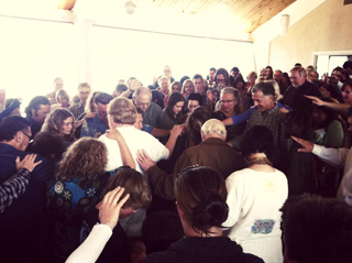 gathering in prayer at Church by the Sea