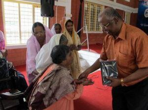 sick-woman-receiving-bible-from-paul-ciniraj1