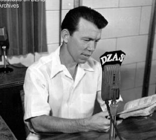 Bowman at microphone
