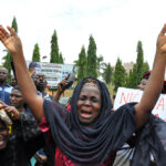 A  desperate mother cries out for her daughter, kidnapped in Nigeria  (AP Photo/ Gbemiga Olamikan)