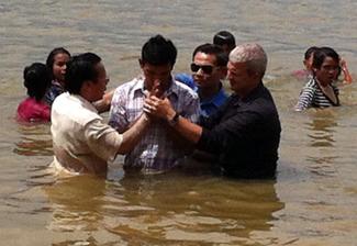 Paul conducting baptisms