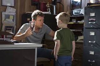 Actor Greg Kinnear, playing Todd, with Connor Corum, playing Colton