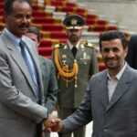 Iranian President Mahmoud Ahmadinejad (R) shakes hands with Eritrean President Issaias Afeworki in Tehran in May 2008