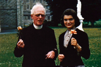 Jackie with Irish priest before her marriage