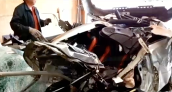 Remains of Honda Civic after collision with big rig