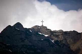 Cross-on-mountain-peak