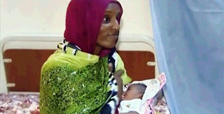 Ibrahim prior to arrest with new baby