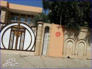 """The Arabic letter """"n"""" (inside red circle), signifying """"Nasarah"""" (Christian), on a Christian home in Mosul (photo AINA)"""