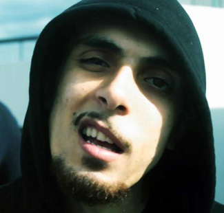 The rapper in a hoody before his trip to Syria