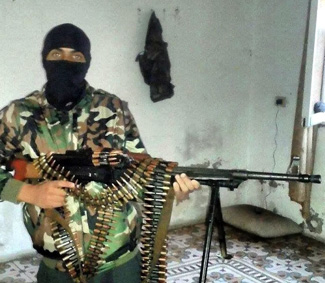 After his radicalization, Bary poses with machine gun