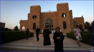 Iraqi Christians leave St. Joseph's Church after a mass in Irbil, the capital of the autonomous Kurdish region, on July 20