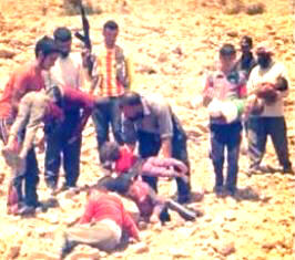Kurdish men carry the bodies of children who died after being driven from their homes with nothing to eat or drink