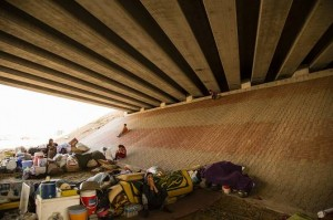 Forcibly displaced Yazidi Kurds camp under a bridge in a city in northern Iraq.  (Photo by Joseph Rose)