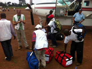 A team of medical workers disembarks the MAF airplane in Boende. MAF has been transporting supplies and personnel to this remote part of the DRC to combat Ebola outbreak. Photo by Nick Frey