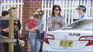 Police talk with parents outside Maronite College of the Holy Family in Parramatta, Sydney (photo: Cameron Richardson).