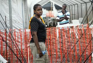 Helena Henry outside Ebola clinic in Monrovia, Liberia (Glenna Gordon; Wall Street Journal)