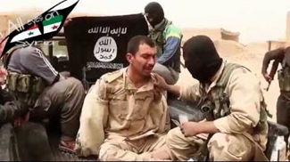 ISIS with captured Iraqi soldier