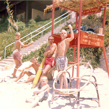 Dale Ghere (in red trunks) lifeguarding at St. Ann's Beach
