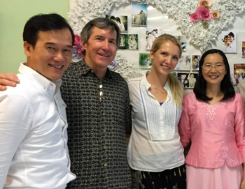 Pastor Khajorn (left) and his wife Gai (far right) meet with team visiting from California, Tom Ravensberg and Beka Farrar