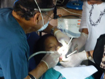 Dr. Yamamoto treats a young patient