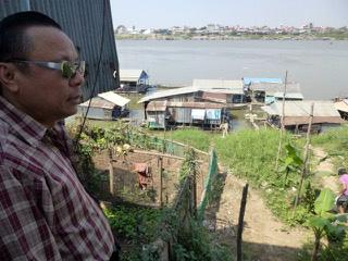 Paul Ai surveys boats where Vietnamese immigrants live