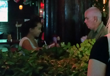 Older man with young girl at bar