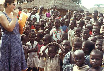 Lorella greets kids in DR Congo, 1982