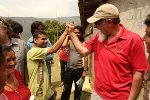 Residents of a village in Nepal celebrate the delivery of relief supplies (Baptist Press)