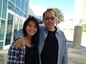 John Mira, with his daughter, Wisdom.