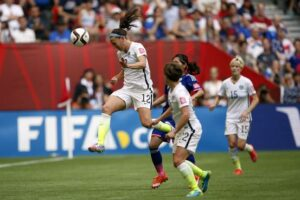 Holiday wins the header against Japan.