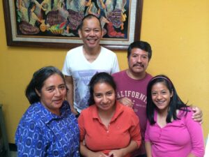John Mira, ministering in Guatemala, with the family pastoral of the Iglesia Cristiana La Puerta.