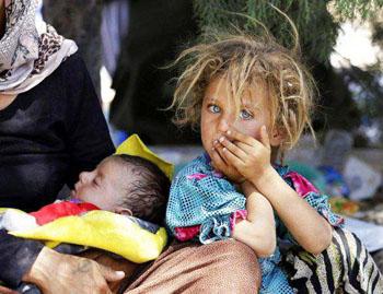 Yazidi girl holds brother