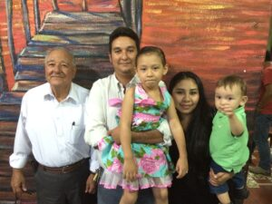 Ismael with his son Carlos, named after his beloved brother, with Carlos' family.