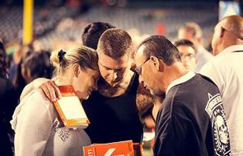 Counselor prays with couple
