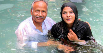 Dr. Saleem Massey baptizing a new believer