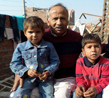 Dr. Saleem Massey with orphans whose parents were burned alive by radical Muslims