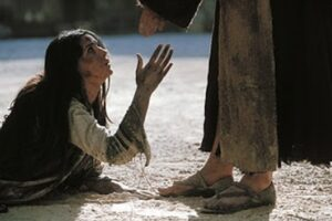 Woman caught in adultery at the feet of Jesus