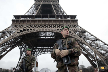 Soldiers stand guard following Paris attacks