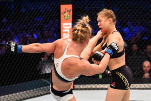 Holm and Rousey in the ring