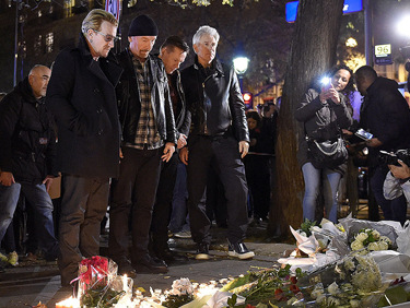 The group U2 pays respects to victims near Bataclan